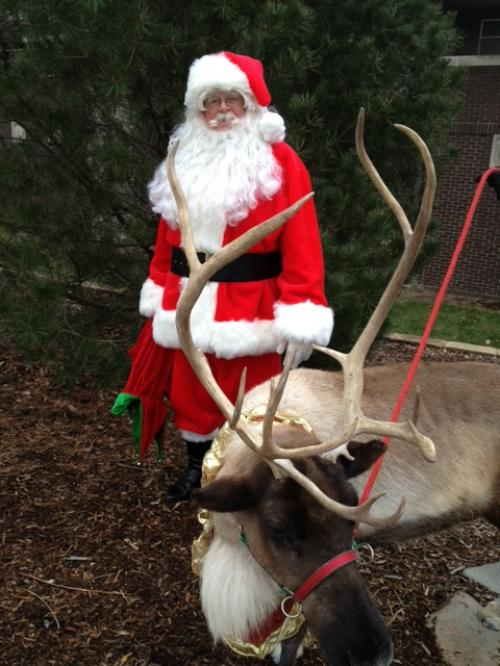 Lockett as Santa with his reindeer